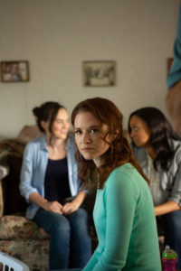 L to R: Army wives Amanda Bradley (Madeline Carroll), Heather Turner (Sarah Drew) and Tonya Lewis (Tia Mowry) seek strength in each other upon hearing news of the troop surge in INDIVISIBLE--in theaters October 26, 2018. (Photo courtesy of © 2018 Provident Films LLC and The WTA Group, LLC. All rights reserved.)